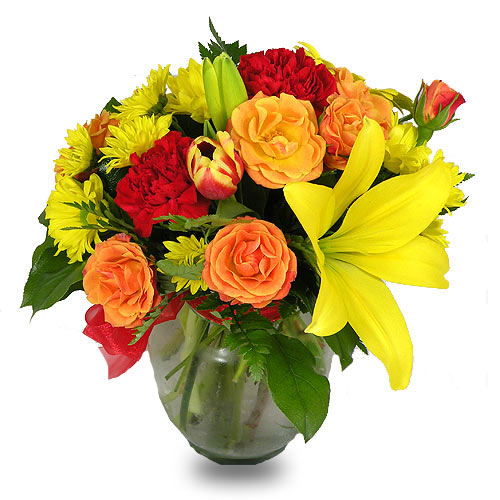 A Wylie Flower Shop exclusive. Nature&quot;s glow is abundantly present in this vibrant design. This spring selection has a smile guarantee.<br/><br/>